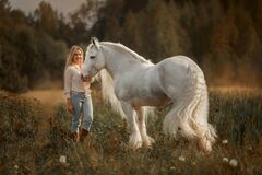 Free Beautiful Young Woman With White Tinker Cob In An Autumn Royalty Free Stock Image - 180210486