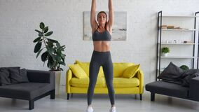 Beautiful young woman woman doing abdominal exercises in room