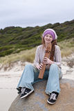 Beautiful young woman with wooden flute Royalty Free Stock Image