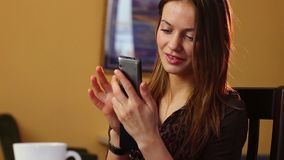 Beautiful young woman at work writes message mobile phone office. Stock footage stock video footage