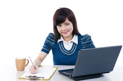 Beautiful young woman working Stock Photo