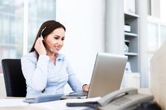 Beautiful young woman working as spokeswoman. Portrait of young beautiful spokeswoman - Beautiful young woman working as spokeswoman call center Royalty Free Stock Photography