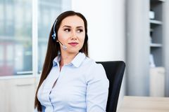 Beautiful young woman working as spokeswoman. Portrait of young beautiful spokeswoman - Beautiful young woman working as spokeswoman call center Stock Images
