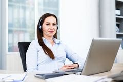 Beautiful young woman working as spokeswoman. Portrait of young beautiful spokeswoman - Beautiful young woman working as spokeswoman call center Stock Photography