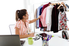 Beautiful young woman working in designer studio. Royalty Free Stock Photography