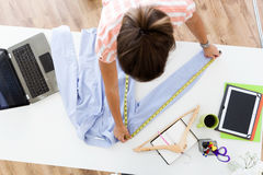 Beautiful young woman working in designer studio. Stock Images