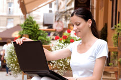 Beautiful young woman working freelance Stock Photography