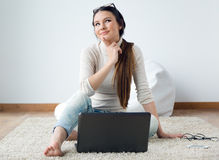 Beautiful young woman working on her laptop at home. Royalty Free Stock Photography