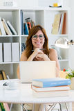 Beautiful young woman working with her laptop at home. Royalty Free Stock Photos