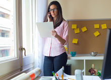Beautiful young woman working in her office. Portrait of beautiful young woman working in her office Stock Image