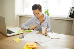 Beautiful young woman working at home Stock Photography