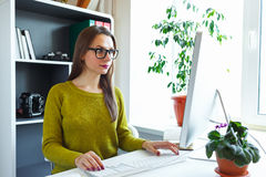 Beautiful young woman working from home Royalty Free Stock Photos