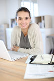 Beautiful young woman working on laptop Royalty Free Stock Photography