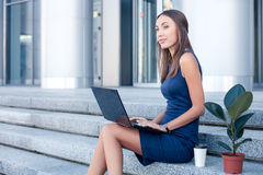 Beautiful young woman is working with a notebook Stock Image