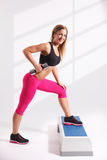 Beautiful young woman working out Stock Photo