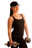 Beautiful young woman working out with dumbels in fitness gym. Beautiful young woman working out with dumbels in a fitness gym Stock Image