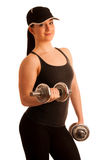 Beautiful young woman working out with dumbels in fitness gym. Beautiful young woman working out with dumbels in a fitness gym Stock Photos