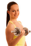 Beautiful young woman working out with dumbels in fitness gym. Beautiful young woman working out with dumbels in gym Royalty Free Stock Images