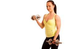 Beautiful young woman working out with dumbels in fitness gym. Beautiful young woman working out with dumbels in fitness Royalty Free Stock Photo