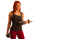 Beautiful young woman working out with dumbels in fitness gym. Beautiful young woman working out with dumbels in fitness Royalty Free Stock Photography
