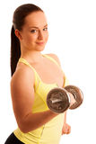 Beautiful young woman working out with dumbels in fitness gym. Beautiful young woman working out with dumbels in  gym Stock Image