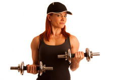 Beautiful young woman working out with dumbels in fitness gym. Isolated Stock Photos