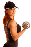 Beautiful young woman working out with dumbels in fitness gym Stock Photography