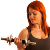 Beautiful young woman working out with dumbels in fitness gym. Isolated over white Royalty Free Stock Images