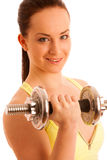 Beautiful young woman working out with dumbels in fitness gym. Isolated over white Stock Image