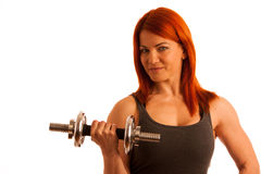 Beautiful young woman working out with dumbels in fitness gym. Over white background Royalty Free Stock Photos