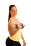 Beautiful young woman working out with dumbels in fitness gym. Beautiful young woman posing after working out with dumbels in fitness gym Royalty Free Stock Images