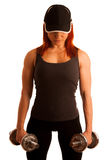 Beautiful young woman working out with dumbels in fitness gym Royalty Free Stock Photography
