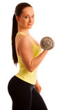 Beautiful young woman working out with dumbels in fitness gym. Beautiful young woman posing after working out with dumbels in fitness gym isolated Stock Image