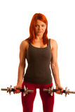 Beautiful young woman working out with dumbels in fitness gym Stock Photo