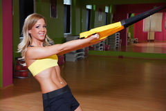 Beautiful young woman working out. In the gym Royalty Free Stock Photography