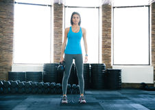 Beautiful young woman working out with kettle ball Royalty Free Stock Photo