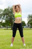 Beautiful young woman working out in a park Royalty Free Stock Photos