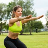 Beautiful young woman working out in a park Stock Image