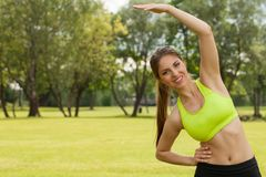 Beautiful young woman working out in a park Royalty Free Stock Photo