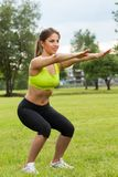 Beautiful young woman working out in a park Stock Images