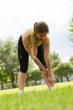 Beautiful young woman working out in a park Royalty Free Stock Photography