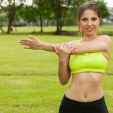 Beautiful young woman working out in a park Stock Photography