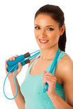 Beautiful young woman working out with speed rope isolated over Stock Image