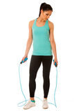 Beautiful young woman working out with speed rope isolated over Royalty Free Stock Photo