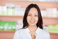 Beautiful young woman working in pharmacy Royalty Free Stock Photos