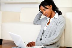 Beautiful young woman working relaxed on laptop Stock Photography