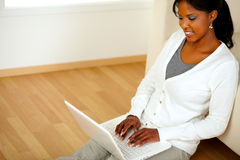 Beautiful young woman working relaxed on laptop Royalty Free Stock Photography