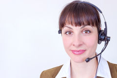 Call center. Beautiful young woman working in a telephone customer service, photography Stock Images