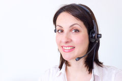 Call center. Beautiful young woman working in a telephone customer service, photography Royalty Free Stock Photos