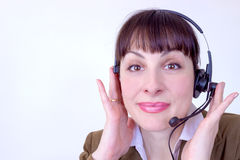 Only good news. Beautiful young woman working in a telephone customer service,photography Stock Photos
